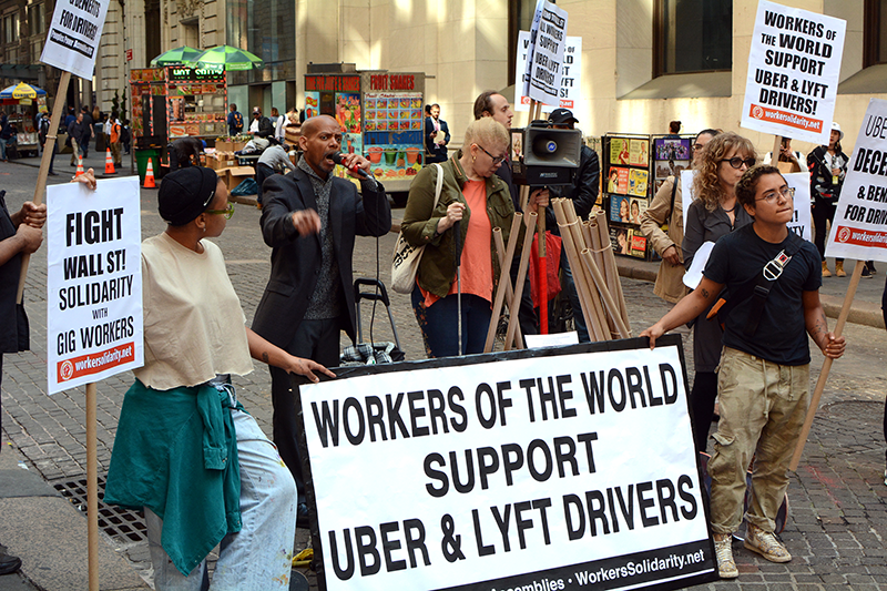 New York, NY, USA -- May 8th, 2019: Uber and Lyft Drivers With Signs on Strike and Protesting Outside the New York Stock Exchange at 26 Wall Street (By Cory Seamer)