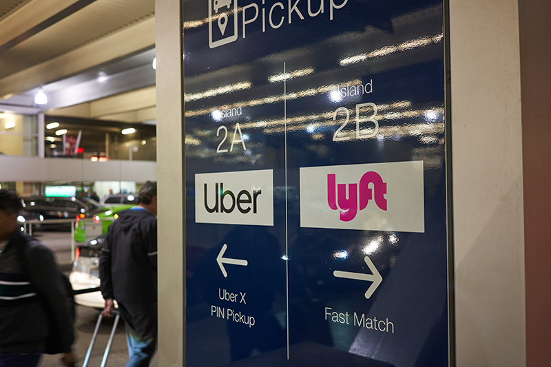 Portland, Oregon, USA - Dec 4, 2019: Uber X and Lyft PIN Pickup area in Portland International Airport at night. (By Tada Images)